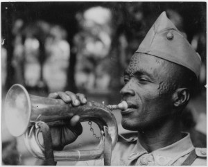 A Congo solider blowing a local horn. 1950