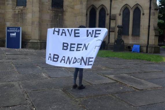 A student protesting at the University of Huddersfield lindaikeji.blogspot.com