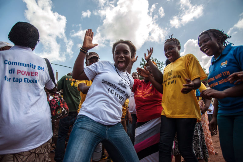 Sierra Leoneans jubilating  after their country has been declared Ebola free