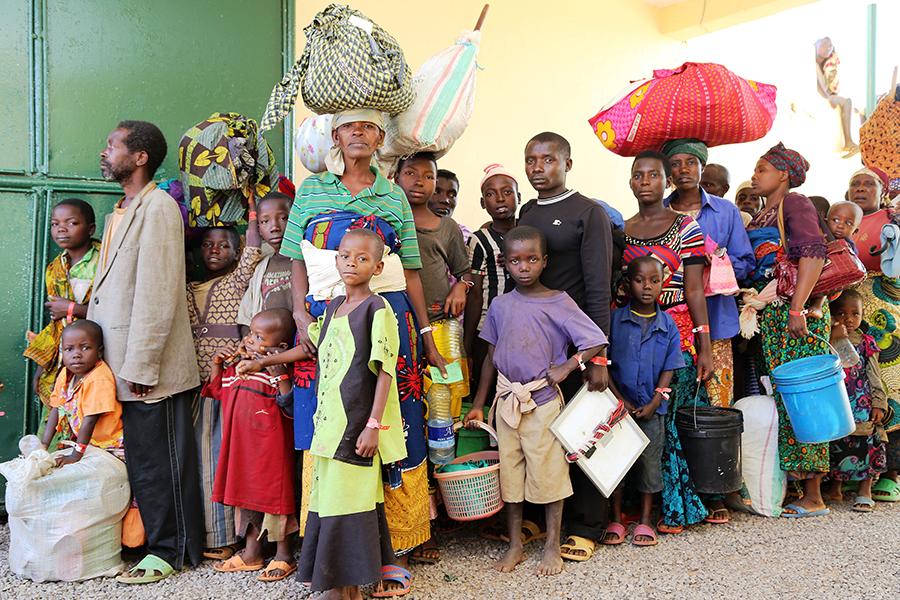 Burundi refugees leaving Lake Tanganyika soccer stadium for Nyarugusu refugee camp. Credit - www.crs.org