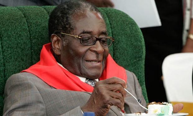 Mugabe (92) is back in Zimbabwe looking healthy after rumors of his collapse Credit: Guardian