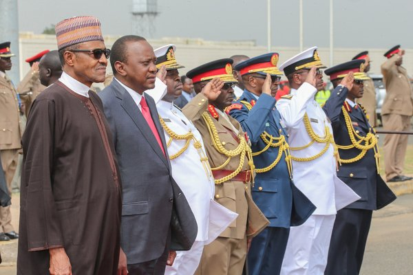President Muhammadu Buhari, President Uhuru Kenyatta and other Kenyan officials at the memorial for the fallen Kenya soldiers
