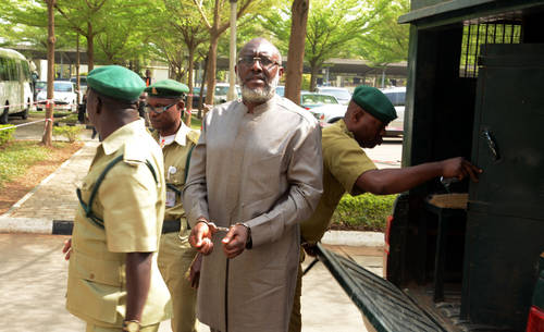 Olisa Metuh. Maybe he was handcuffed so that he will not be able to destroy any more evidence