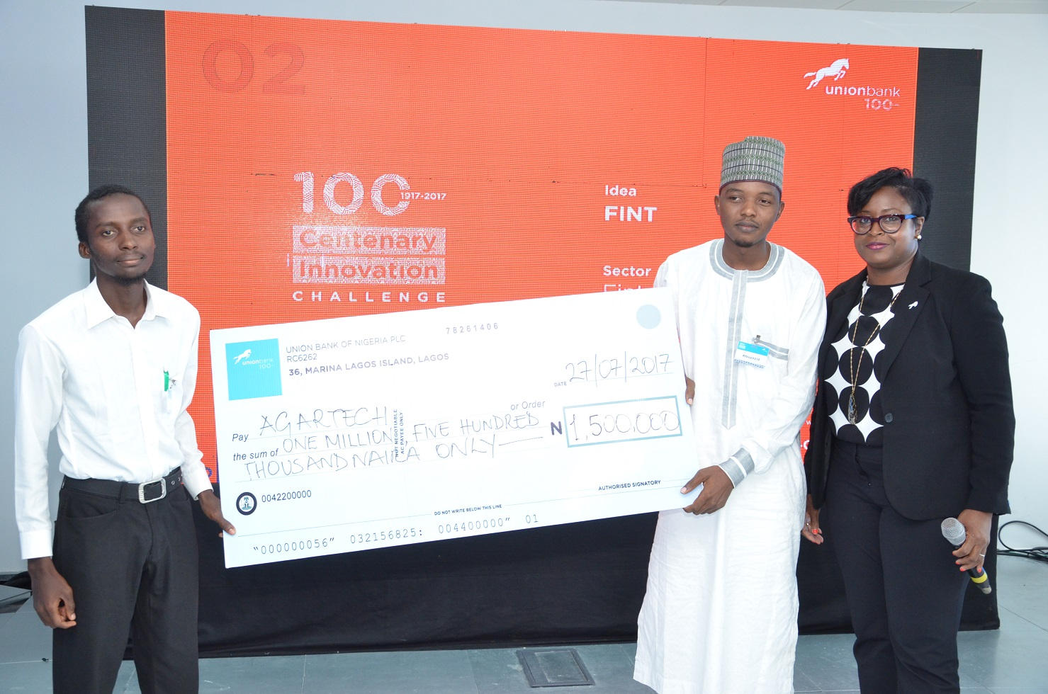 Lola Cardoso, Head Group Corporate Strategy Union Bank Presents the cheque to The first runners-up, Abuyaziz Musaddiq and Mohammed Mustapha Ilyas